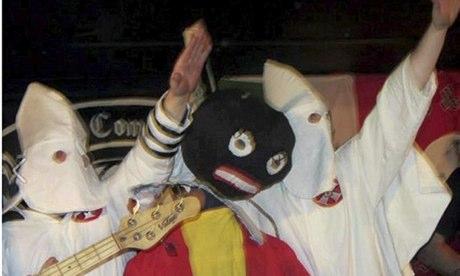 Video still showing Klu Klux Klan costumes and golliwog