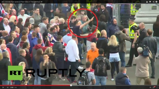 A loyalist protester nazi-salutes. Screencap taken from this video.