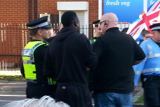 Paul Golding and his security team thugs attempt to start a fight with a black army reservist who called them racist.