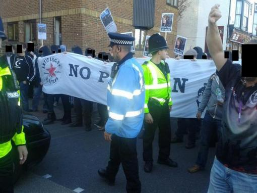 Antifascists block the Britain First march.