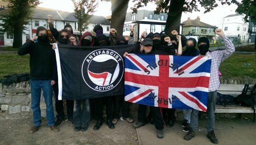 Brighton Antifascists display the fascist flag they took off some far-right idiot.