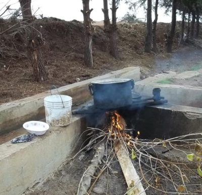 Dinner on the fire. Also the most common way to wash in Rojava.