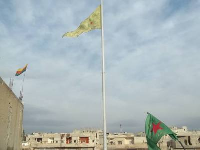 Flags fly in Central Kobane. They compete with an equally large Turkish flag that flies across the border north of the city.